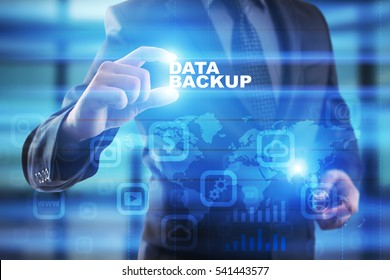 Businessman selecting data backup on virtual screen.