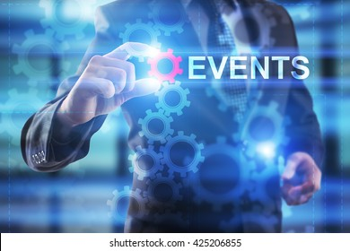 Businessman is selecting Events on the virtual screen.
