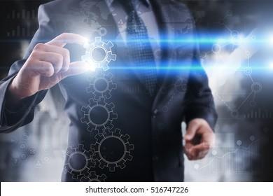 Businessman selecting gears_bg_str on virtual screen.