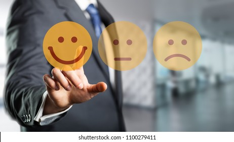 businessman is selecting a happy mood emoticon