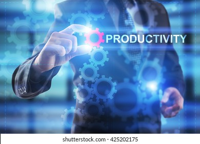 """Businessman is selecting """"Productivity"""" on the virtual screen."""