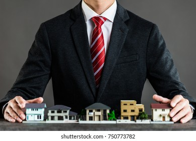 Businessman selling houses