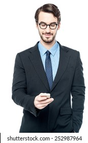 Businessman sending message in his mobile phone