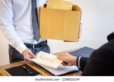 Businessman sending a resignation letter to employer boss in order to dismiss contract, changing and resigning from work concept.