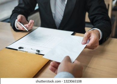 Businessman sending a resignation letter to employer boss in order to resign dismiss contract, changing and resigning from work concept.