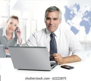 businessman senior expertise teamwork world map global communication [Photo Illustration]