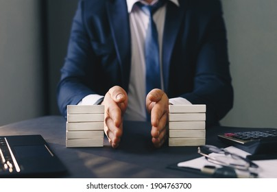 Businessman separates wooden block. Property division. Divorce and legal services.