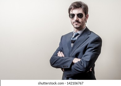 businessman serious with sunglasses on gray background