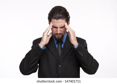 Businessman with severe headache looking down
