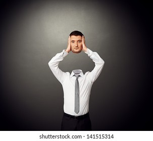 businessman with the severed head in his hands