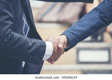 Businessman shake hand deal with trustworthy dependable truthful. People inspiring handshake greeting business world. Trustworthy trust believe in truth and ability. Shake hand success deal concept.