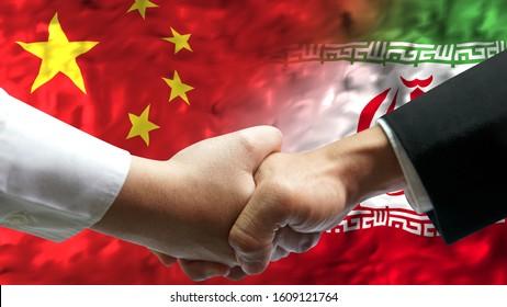 Businessman shake hand over China and Iran animation waving flag