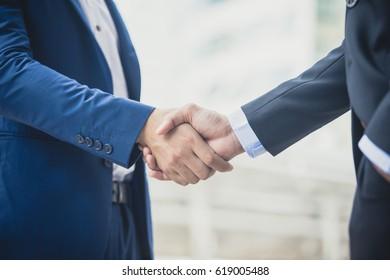 Businessman shake hand together, agreement business concept, vintage color tone