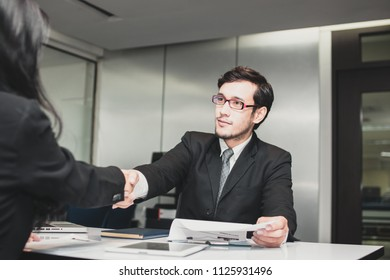businessman shake hands with candidate after finishing interview for a job
