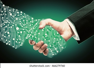 Businessman shaking digital partners hand on green background