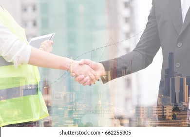 Businessman is shaking hand with engineer