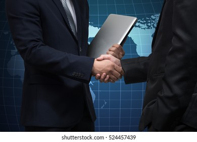 Businessman shaking hand with globe network background