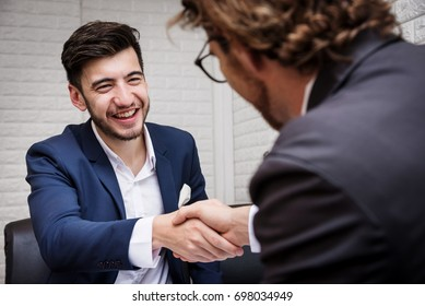 Businessman Shaking Hand with Partner After Sign Contract in Meeting Room with Happy - Business Concept