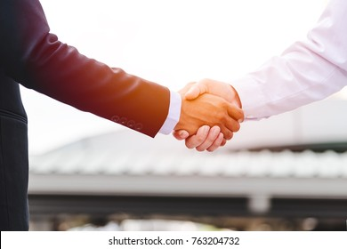 businessman shaking hand success deal, happy partnership of business company, casual handshaking agreement,teamwork
