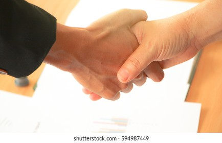 businessman shaking hand to success To negotiate a job with his partner