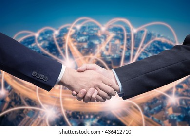 Businessman shaking hand with technology connection background
