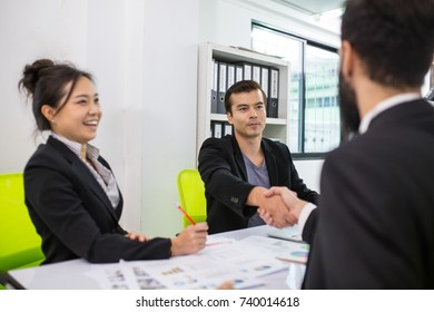 Businessman shaking hands after finished meeting in the office.
