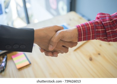 Businessman are shaking hands after reaching agreement on the project.