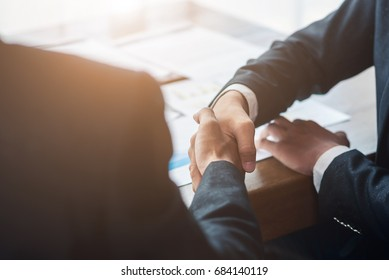 Businessman shaking hands agreement partners to business in conference Business negotiations