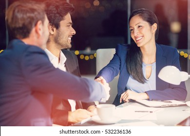 Businessman shaking hands with colleague in office