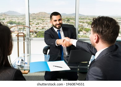 Businessman shaking hands with a company executive after making a lucrative business deal. Smiling sales representative making a successful sale