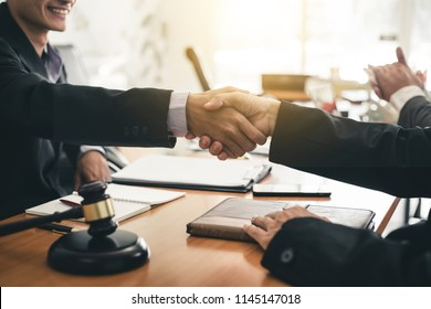 Businessman shaking hands discussing a contract agreement.