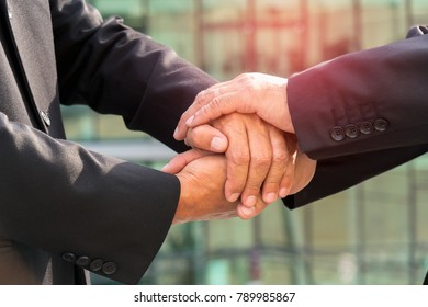 Businessman shaking hands each other outdoor, Business agreement concept.