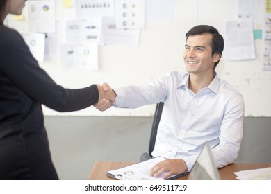 Businessman shaking hands greeting each other, 20-30 year old.