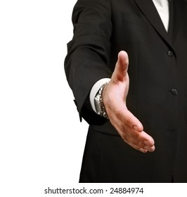 A businessman shaking hands to seal a deal. Shallow depth of field, focus on finger-tips.