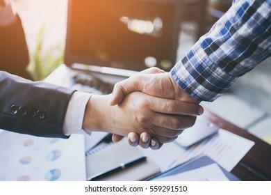 Businessman shaking hands for success.
