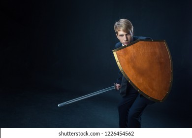 Businessman with shield and sword. Risk management and information protection concept, gdpr