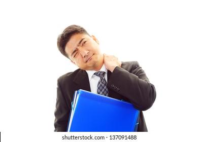 Businessman with shoulder pain.