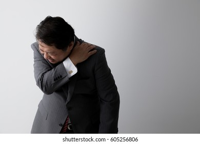Businessman with shoulder pain, middle aged man