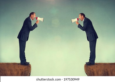 businessman shouting at each other through loudhailers or megaphones