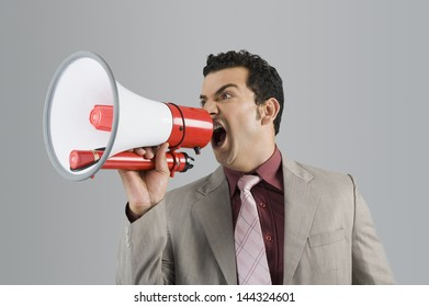 Businessman shouting into a megaphone