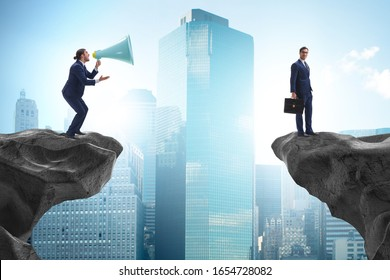 Businessman shouting with loudspeaker at others