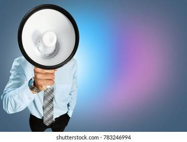 Businessman shouting in a megaphone