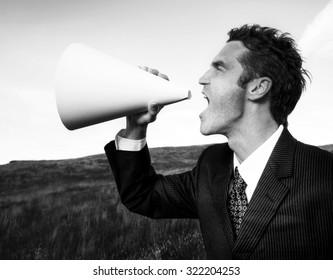 Businessman Shouting Megaphone Field Concept