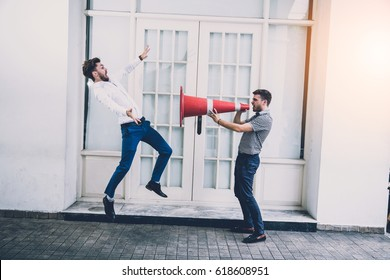 Businessman Shouting Megaphone to his friend business fight Concept