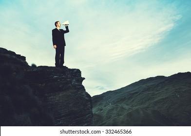 Businessman Shouting Megaphone Top Mountain Concept