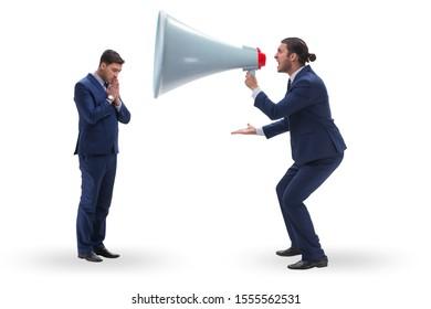 Businessman shouting through large loudspeaker