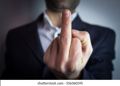 businessman show fuck you sign