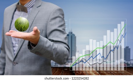 Businessman show growth chart of wind farm project