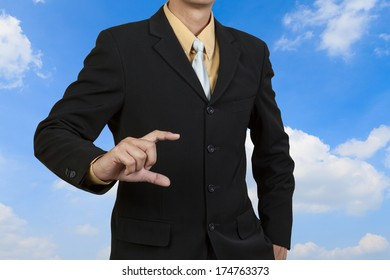 Businessman show his hand on sky background