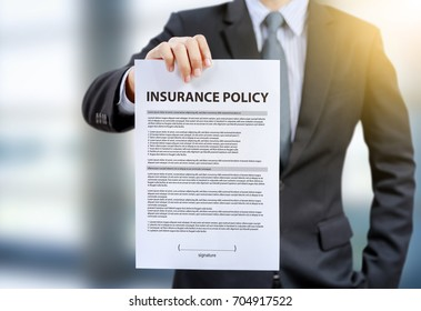 businessman show insurance policy
